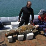 Police Commander pulls up a large artifact from a Roman wreck near Varazze.